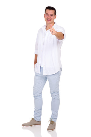 posing  agree: good looking young man giving thumb up on white background