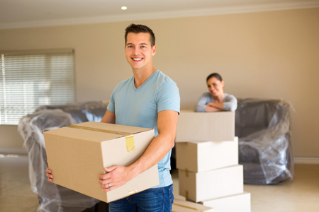 portrait of young couple moving in to new home