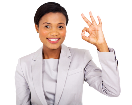 hand sign: happy african american businesswoman giving ok hand sign
