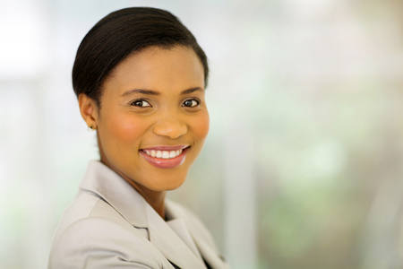 woman close up: cheerful young businesswoman in modern office