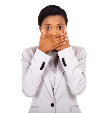 young executive: surprised african american woman covering her mouth with hands Stock Photo