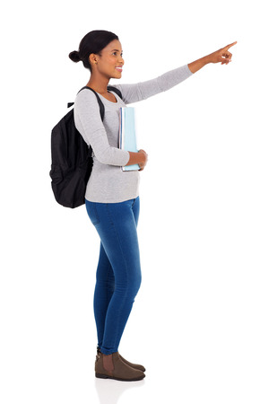 woman pointing: side view of african university student pointing on white background