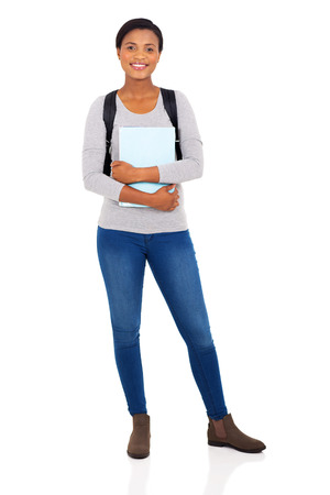 colegios: ni�a de la universidad africana joven magn�fica aislada en el fondo blanco
