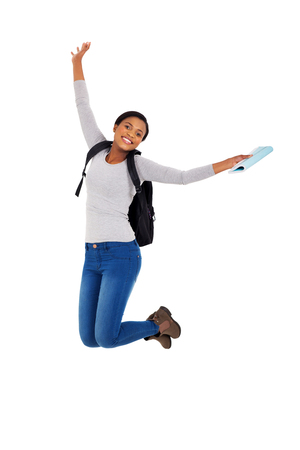 college: excited african american college student jumping Stock Photo