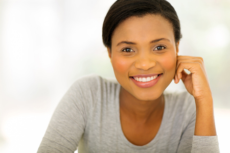 happy black woman: close up portrait of happy young african american woman