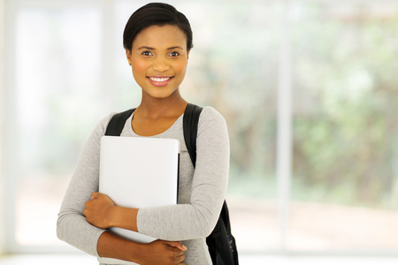 adult student: happy female african american college student Stock Photo