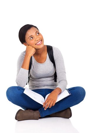 girl in jeans: beautiful young female college student looking up on white background Stock Photo