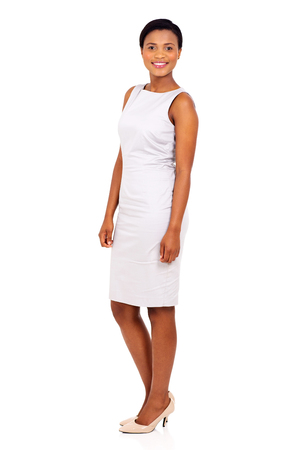 mujer trabajadora: side view of african woman standing on white background Foto de archivo