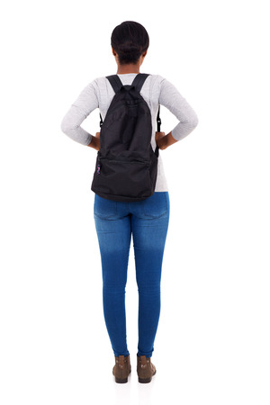 rear view of african female college student isolated on white background Standard-Bild
