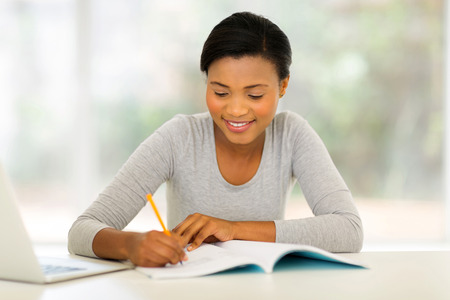 happy african female college student studying
