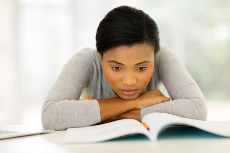 adult student: bored american university student lying on desk