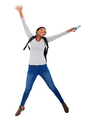 brincando: enérgica estudiante universitario africano saltando de alegría Foto de archivo
