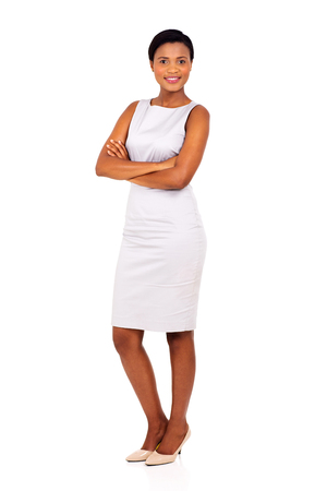 working dress: beautiful young black business woman posing on white background