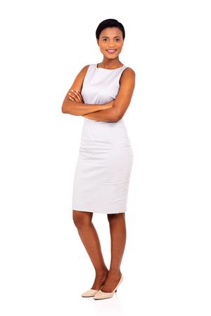 elegant woman: joven y bella mujer de negocios negro que presenta en el fondo blanco Foto de archivo