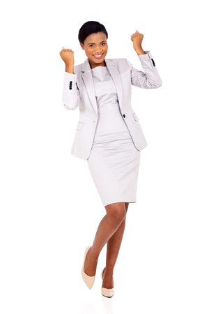 successful black businesswoman waving fists isolated on white background