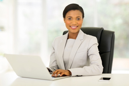 modern businesswoman: elegant young african american businesswoman in modern office