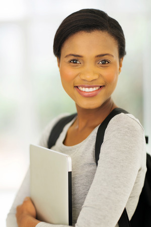 african student: cheerful african american college student with laptop computer