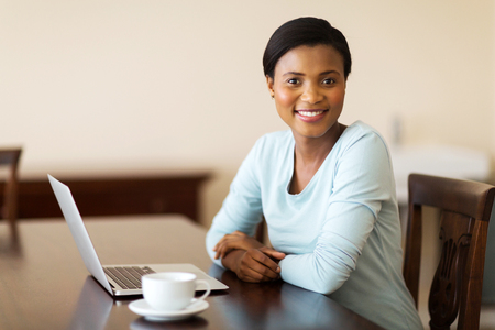 ethnic woman: modern african woman using laptop at home