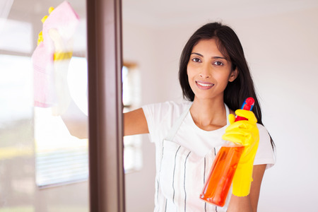 housewife gloves: pretty indian housewife cleaning window glass