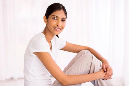 sitting pretty: pretty young indian woman sitting