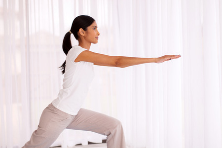 indian yoga: healthy indian woman practicing yoga exercise at home
