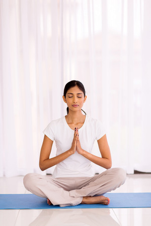 beautiful indian woman meditating in the morning