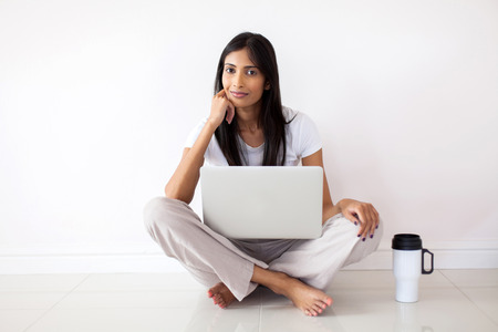 indian woman relaxing on the floor in her new house