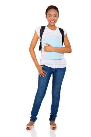 african student: full length portrait of young female african college student on white