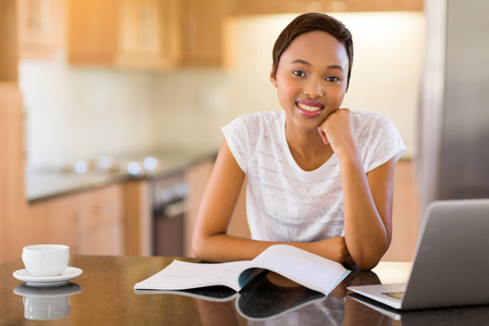 ethnic woman: portrait of pretty female african college student studying at home