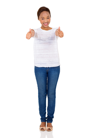 posing  agree: cheerful african american woman thumbs up on white background