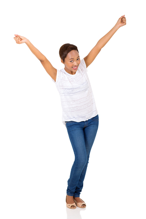 arms up: excited young afro american woman with arms up