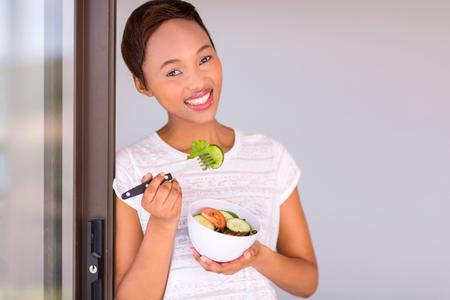 eating salad: attractive black woman eating green salad