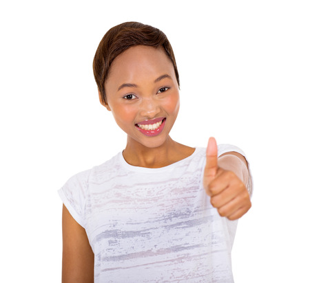 posing  agree: portrait of smiling young african woman giving thumb up Stock Photo