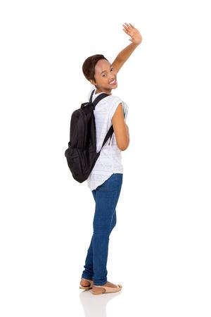 personas saludando: bastante estudiante universitario africano diciendo adiós aislado en fondo blanco