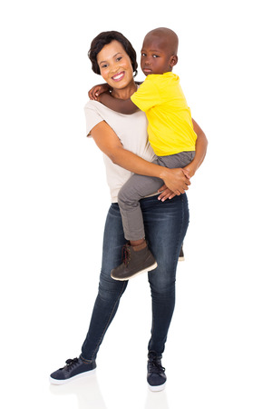family isolated: loving young african mother holding her son on white background Stock Photo