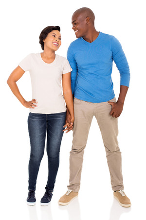 black hands: full length portrait of african couple holding hands on white background