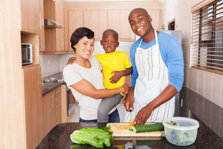 niños negros: african family preparing lunch at home in the kitchen