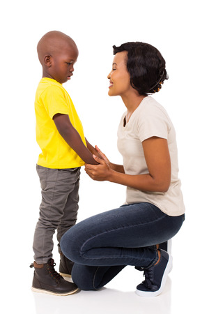 beautiful african woman talking to her son on white background