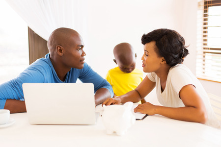 financial planning married: young african couple doing family finances at home