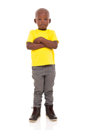 child sad: adorable young african boy with arms crossed on white background