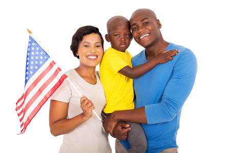 black flag: portrait of young african american family with a USA flag
