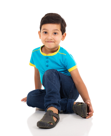 handsome boy: adorable little indian boy sitting on the floor
