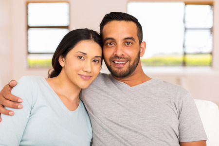 portrait of beautiful young indian couple relaxing at home Stock Photo