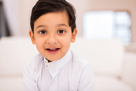 middle eastern clothes: little muslim boy at home Stock Photo