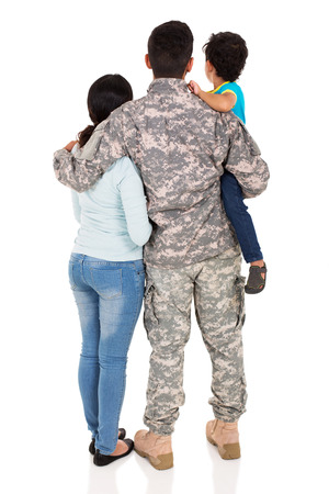 family reunion: back view of young military family isolated on white background