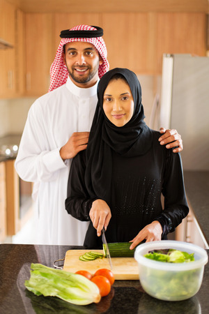 family dinner: Arabian couple in kitchen cooking food