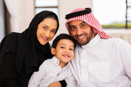 middle adult: happy muslim family spending time together at home