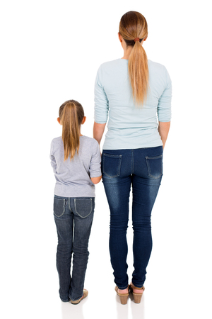 rear view of young woman and her daughter isolated on white background