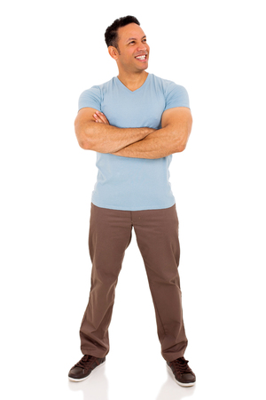 arms folded: happy mid age man with arms folded looking away Stock Photo