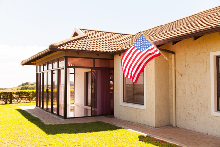 beautiful house with American flag